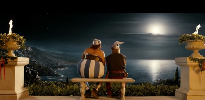 Asterix and Obelix take a seat after their work is done, and gaze out over the sea