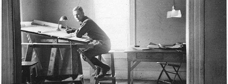 Old picture of a man at a drawing board