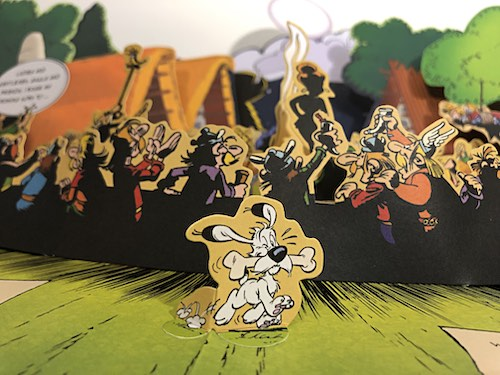 Dogmatix in front of the banquet in Asterix on the Warpath