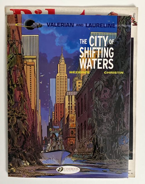 A copy of a modern reprinting of Valerian in album form on top of an issue of Pilote Journal for size comparison's sake.