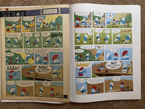 Side by side size comparison of original Smurfs comics to modern reprinting from Papercutz