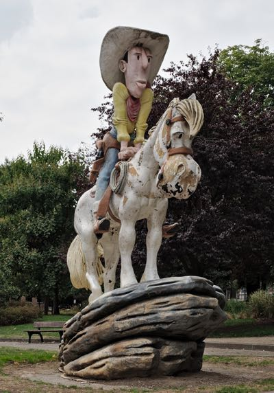 Closeup of Lucky Luke's statue in the park at Charleroi, Belgium
