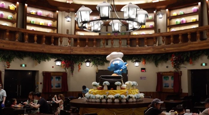 A Smurf statue sits in the center of the Shanghai Smurfs theme park restaurant