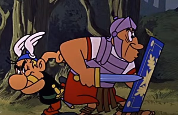 Asterix kicks a Roman in the butt in this still from the Asterix the Gaul movie