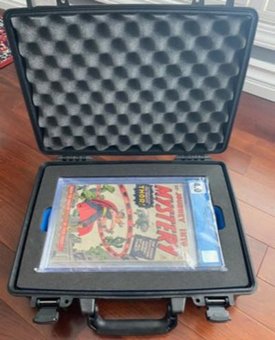 Pelican case holding a slabbed CGC graded first appearance of Thor comic