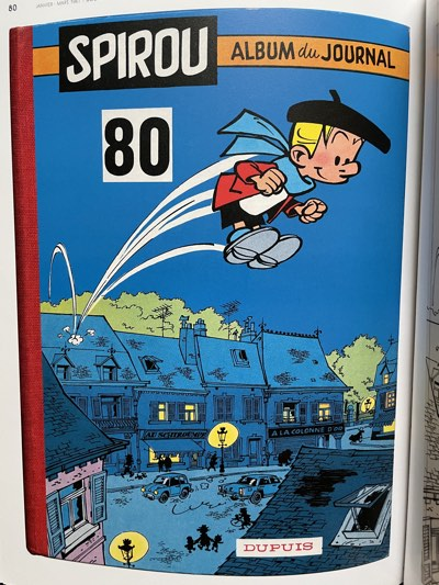 Collected Spirou v80 cover by Andre Franquin featuring Peyo's Benny Breakiron jumping through the town